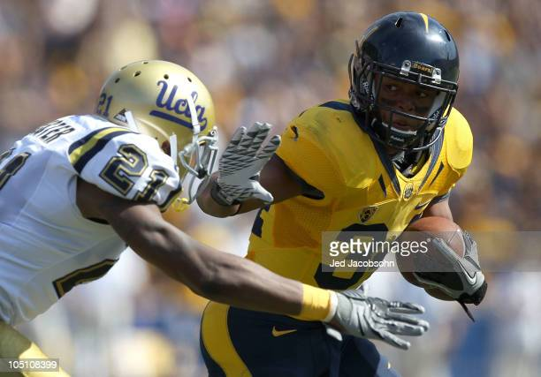 Shane Vereen of the California Golden Bears runs for a touchdown against Aaron Hester of the UCLA Bruins in the first half at California Memorial...