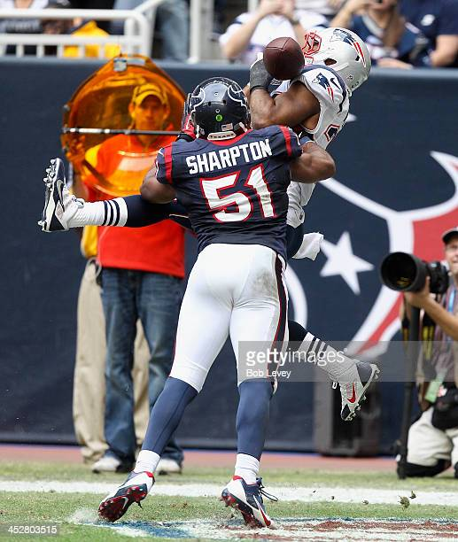 Shane Vereen of the New England Patriots has the ball bounce off his shoulder pad as he his defended by Darryl Sharpton of the Houston Texans at...