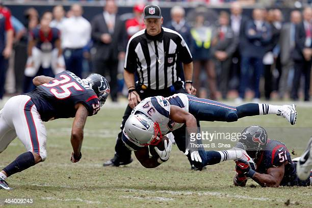 Shane Vereen of the New England Patriots is tackled by Darryl Sharpton of the Houston Texans on December 1 2013 at Reliant Stadium in Houston Texas