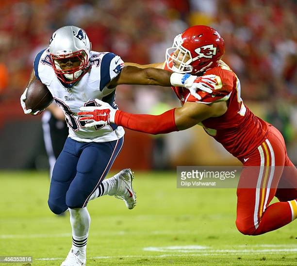 Shane Vereen of the New England Patriots runs the ball against Josh Mauga of the Kansas City Chiefs during the first half at Arrowhead Stadium on...