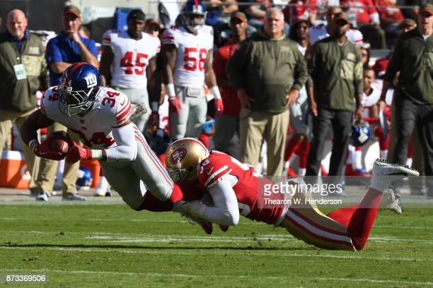 Shane Vereen of the New York Giants is tackled by Reuben Foster of the San Francisco 49ers during their NFL game at Levi's Stadium on November 12...