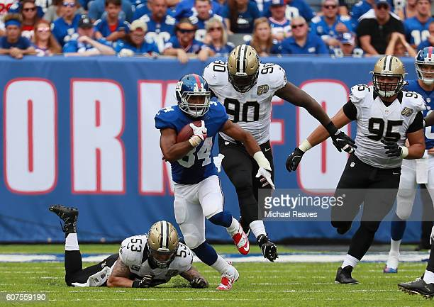 Shane Vereen of the New York Giants rushes against James Laurinaitis Nick Fairley and Tyeler Davison of the New Orleans Saints during the first half...