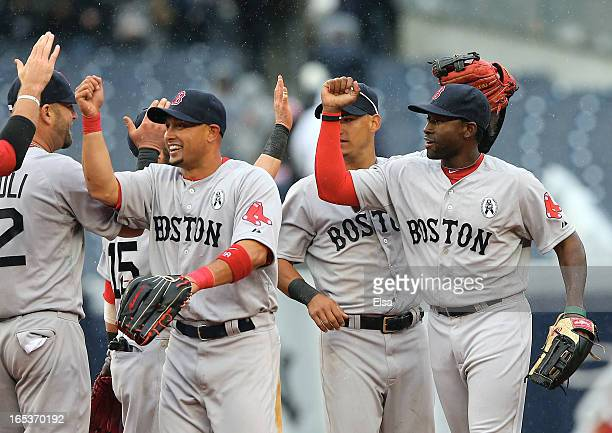 Shane Victorino and Jackie Bradley of the Boston Red Sox celebrate the win over the New York Yankees during Opening Day on April 1 2013 at Yankee...