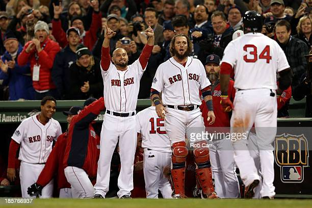 Shane Victorino and Jarrod Saltalamacchia of the Boston Red Sox react after a two run home run in the sixth inning by David Ortiz against the St...