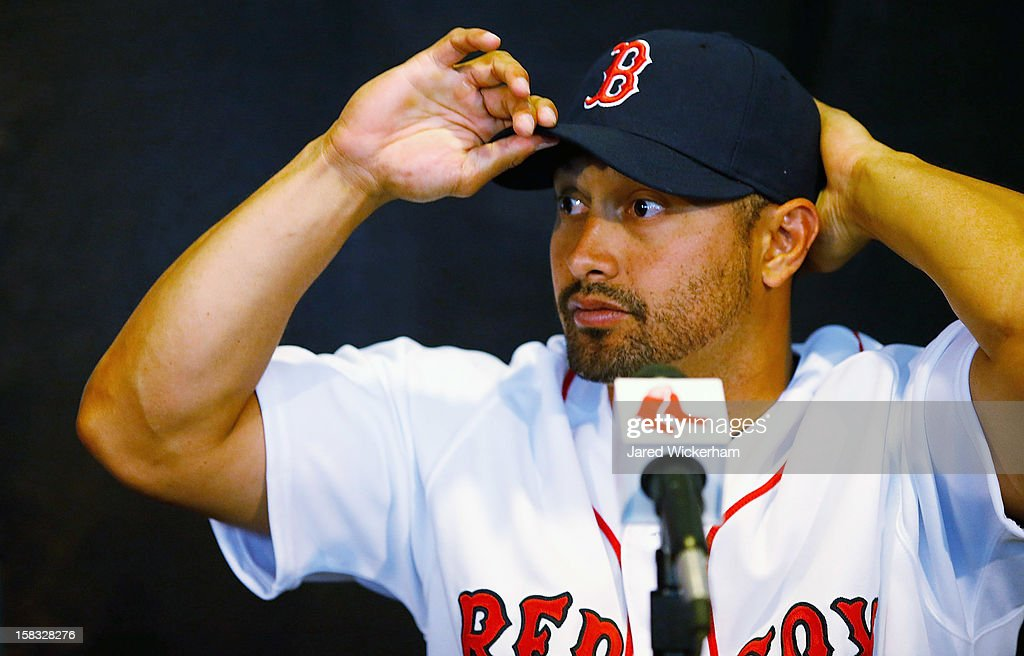 Shane Victorino of the Boston Red Sox adjusts his hat while speaking during a press conference, after signing a three-year contract, on December 13, 2012 at Fenway Park in Boston, Massachusetts.