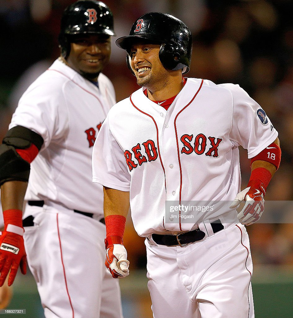 Shane Victorino #18 of the Boston Red Sox and David Ortiz #34 smile after Victorino hit a solo home run in the 2nd inning against Minnesota Twins at Fenway Park on May 8, 2013 in Boston, Massachusetts.