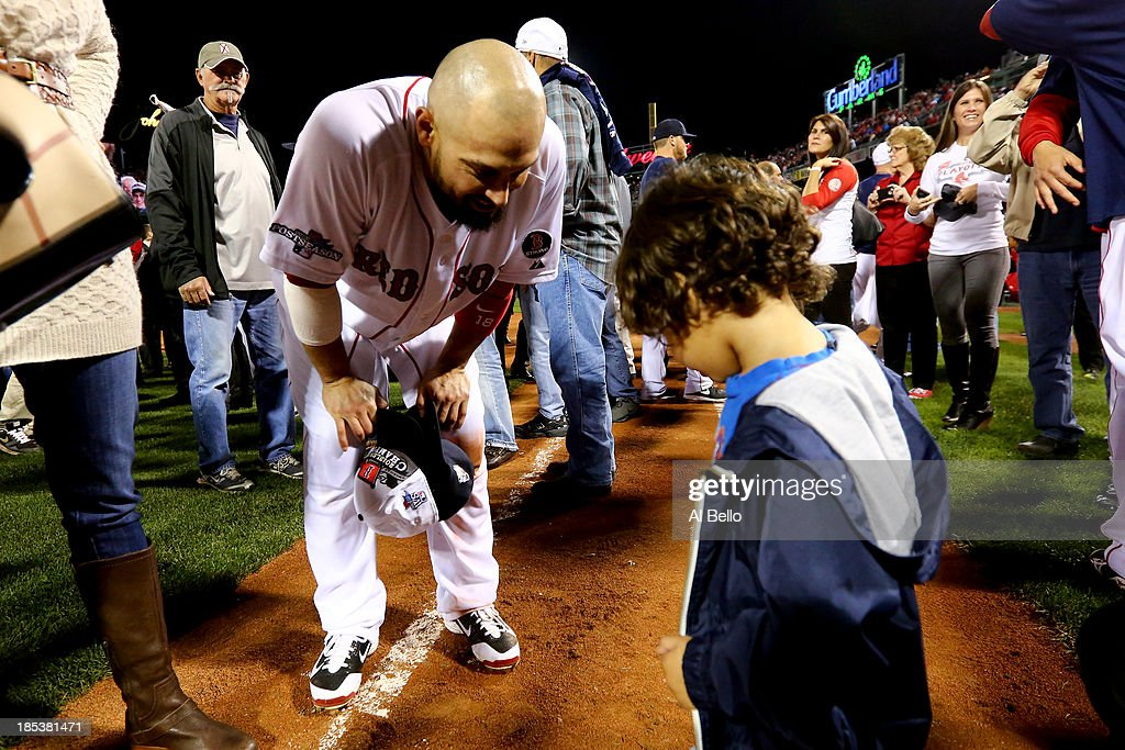 Shane Victorino #18 of the Boston Red Sox celebrates with his son after defeating the Detroit Tigers in Game Six of the American League Championship Series at Fenway Park on October 19, 2013 in Boston, Massachusetts. The Red Sox defeated the Tigers 5-2 to clinch the ALCS in six games.