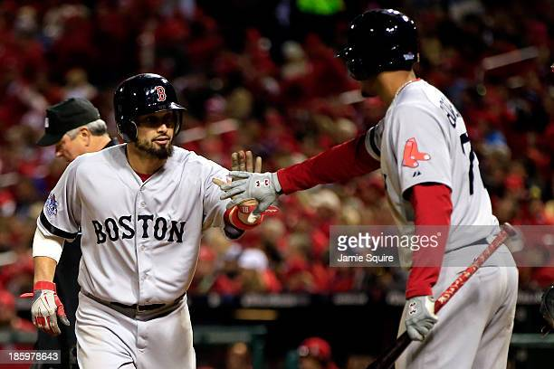Shane Victorino of the Boston Red Sox celebrates with Xander Bogaerts as Victorino scores on a single by Daniel Nava in the sixth inning against the...