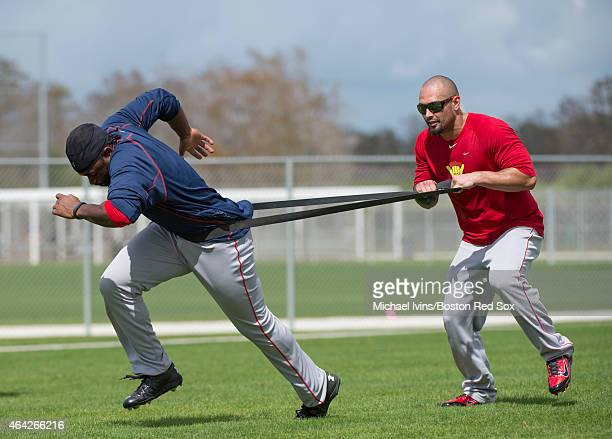 Shane Victorino of the Boston Red Sox holds a resistance band on Jackie Bradley Jr during a Spring Training workout at Fenway South on February 23...