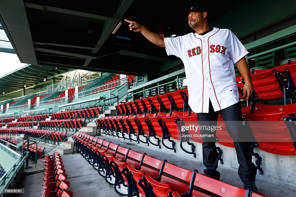 Shane Victorino of the Boston Red Sox points to the Green Monster while looking out over the ballpark after signing a three-year contract and being introduced during a press conference, on December 13, 2012 at Fenway Park in Boston, Massachusetts.