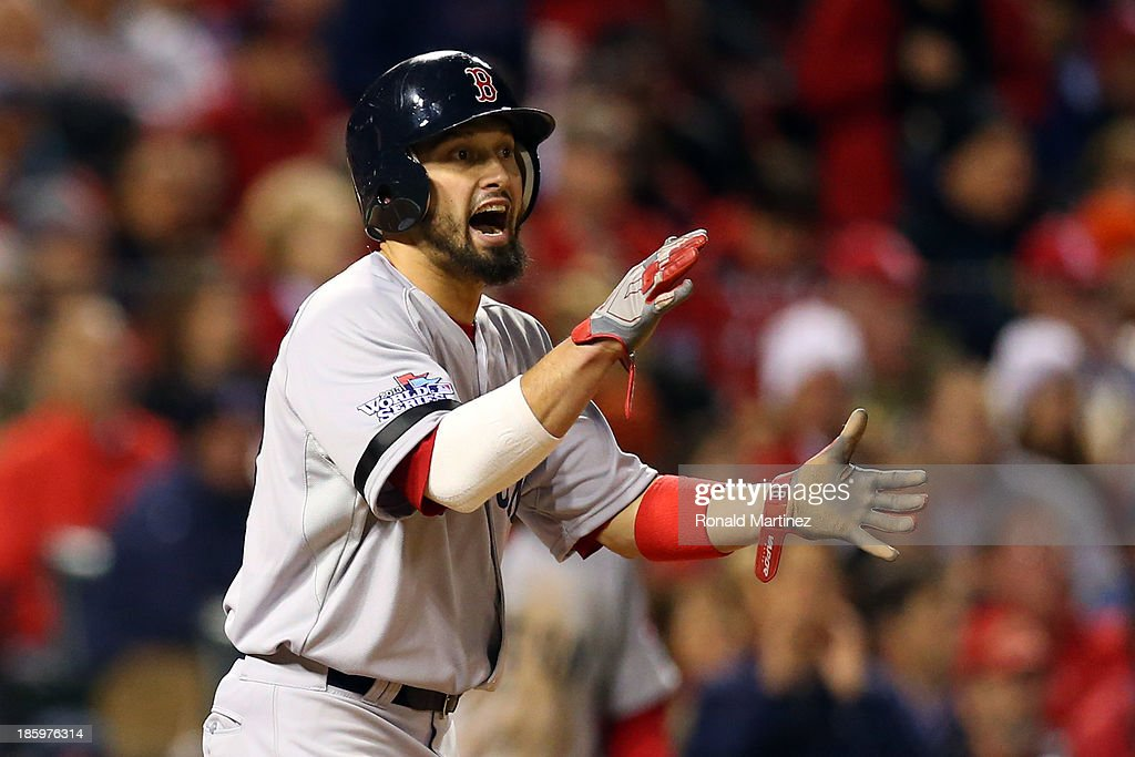 Shane Victorino #18 of the Boston Red Sox reacts after scoring on a single by Daniel Nava #29 in the sixth inning against the St. Louis Cardinals during Game Three of the 2013 World Series at Busch Stadium on October 26, 2013 in St Louis, Missouri.