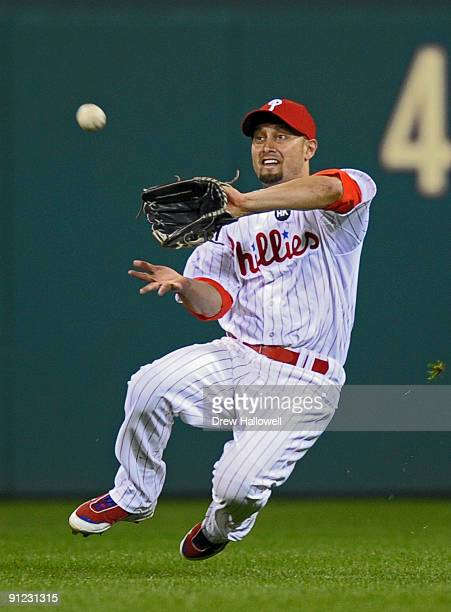 Shane Victorino of the Philadelphia Phillies catches a fly ball during the game against the Houston Astros on September 28 2009 at Citizens Bank Park...