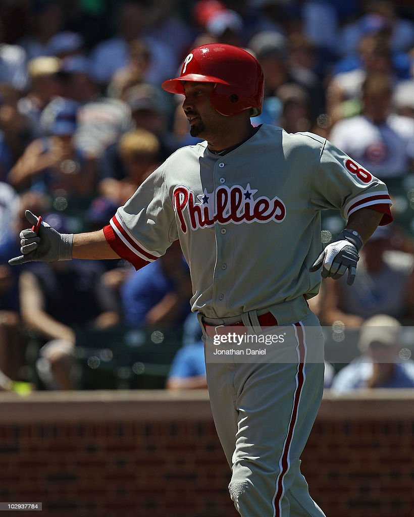 Shane Victorino #8 of the Philadelphia Phillies celebrates a home run in the 4th inning against the Chicago Cubs at Wrigley Field on July 16, 2010 in Chicago, Illinois. The Cubs defeated the Phillies 4-3.