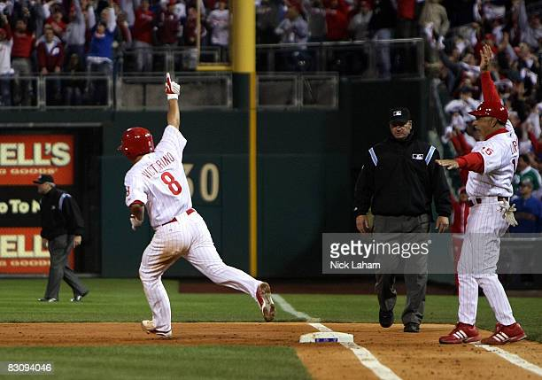Shane Victorino of the Philadelphia Phillies celebrates his second inning grand slam home run against the Milwaukee Brewers during Game 2 of the NLDS...