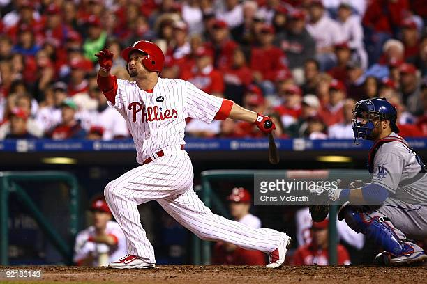 Shane Victorino of the Philadelphia Phillies hits a homerun in the sixth inning against the Los Angeles Dodgers in Game Five of the NLCS during the...