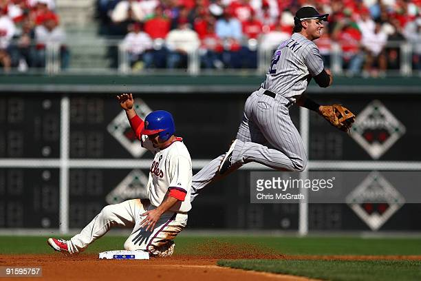 Shane Victorino of the Philadelphia Phillies is forced out at second base by Troy Tulowitzki of the Colorado Rockies on a fielder's choice hit by...