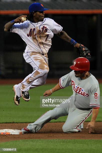 Shane Victorino of the Philadelphia Phillies is out at second as Jose Reyes of the New York Mets throws to first base on May 25 2010 at Citi Field in...