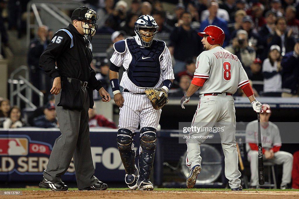 Shane Victorino #8 of the Philadelphia Phillies reacts to the call of home plate umpire Jeff Nelson after striking out as Jose Molina #26 of the New York Yankees looks on in Game Two of the 2009 MLB World Series at Yankee Stadium on October 29, 2009 in the Bronx borough of New York City.