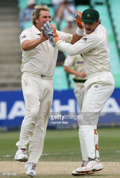 Shane Warne and Adam Gilchrist of Australia celebrate the wicket of Graeme Smith of South Africa during day five of the Second Test between South...