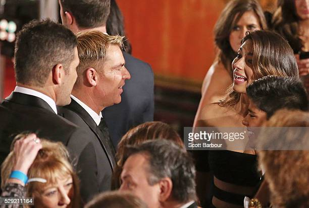 Shane Warne and Brendan Fevola talk to Pia Miller as they arrive at the 58th Annual Logie Awards at Crown Palladium on May 8 2016 in Melbourne...