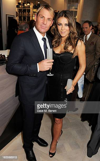 Shane Warne and Elizabeth Hurley attend the launch of Louise Fennell's new book 'Fame Game' at Grace Belgravia on March 12 2013 in London England