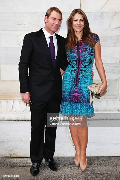 Shane Warne and Elizabeth Hurley attend the Roberto Cavalli Spring/Summer 2013 fashion show as part of Milan Womenswear Fashion Week on September 24,...