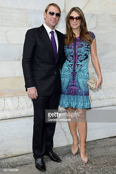 Shane Warne and Elizabeth Hurley attend the Roberto Cavalli Spring/Summer 2013 fashion show as part of Milan Womenswear Fashion Week on September 24...