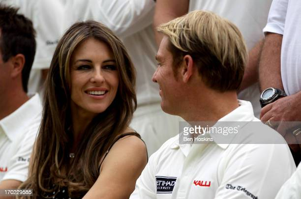 Shane Warne and Elizabeth Hurley look on prior to Shane Warne's Australia vs Michael Vaughan's England T20 match at Cirencester Cricket Club on June...