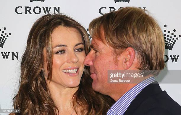 Shane Warne and Elizabeth Hurley pose as they attend the launch of the Shane Warne Foundation's Ambassador Program at Club 23 on November 12 2013 in...