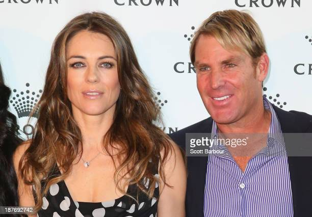 Shane Warne and Elizabeth Hurley pose as they attend the launch of the Shane Warne Foundation's Ambassador Program at Club 23 on November 12, 2013 in...