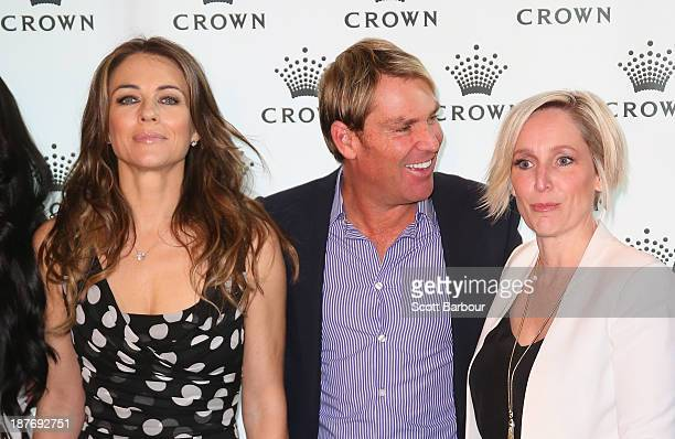 Shane Warne and Elizabeth Hurley pose with Fifi Box as they attend the launch of the Shane Warne Foundation's Ambassador Program at Club 23 on...