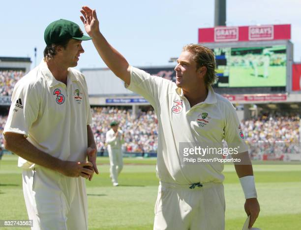 Shane Warne and Glenn McGrath of Australia leave the field at the end of England's 2nd innings in 5th Test match between Australia and England at the...