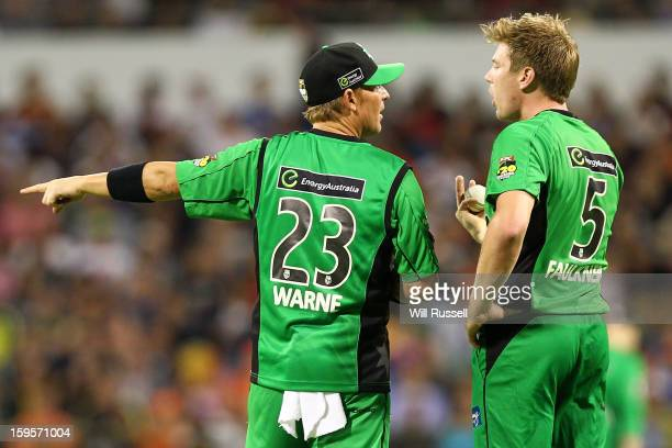 Shane Warne and James Faulkner of the Stars talk fielding positions during the Big Bash League semifinal match between the Perth Scorchers and the...