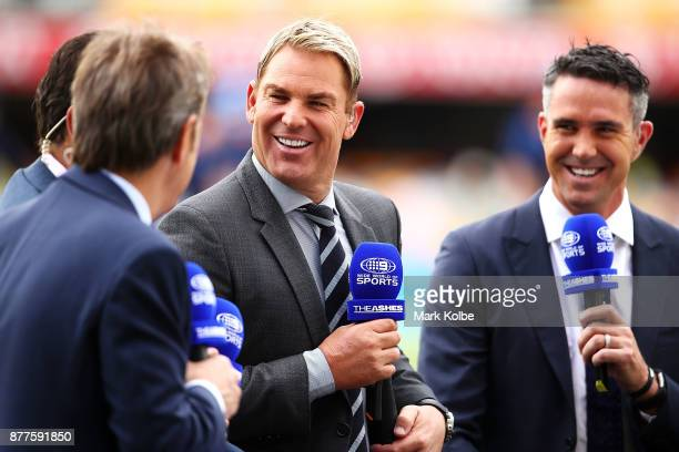 Shane Warne and Kevin Pietersen of the Channel Nine commentary team laugh as they speak on air before play day one of the First Test Match of the...