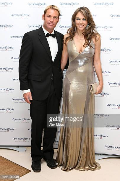 Shane Warne and Liz Hurley Arrives at the Operation Smile Charity Ball at The Hurlingham Club on November 10 2011 in London England