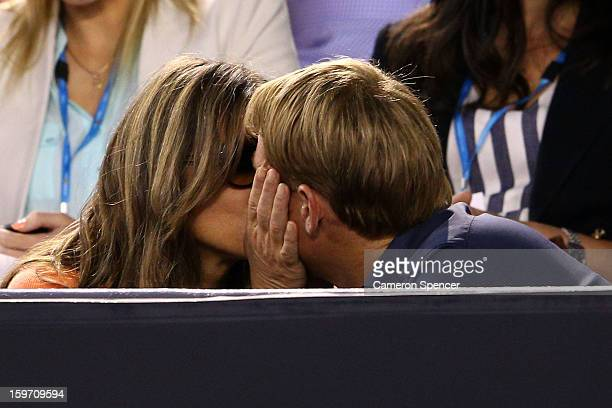 Shane Warne and Liz Hurley kiss at the men's third round match between Roger Federer of Switzerland and Bernard Tomic of Australia during day six of...