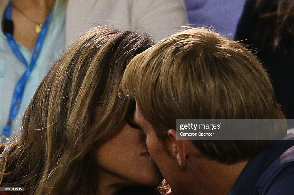 Shane Warne and Liz Hurley kiss at the men's third round match between Roger Federer of Switzerland and Bernard Tomic of Australia during day six of the 2013 Australian Open at Melbourne Park on January 19, 2013 in Melbourne, Australia.