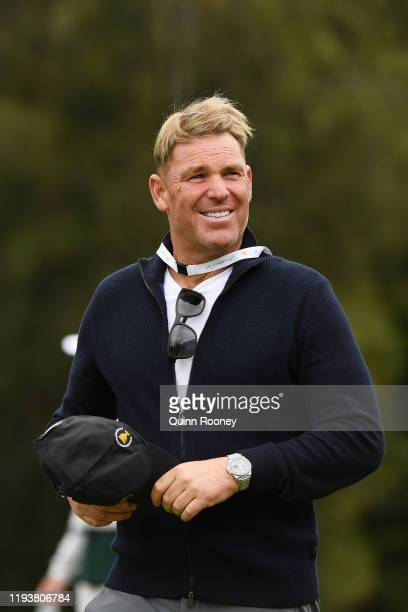 Shane Warne attends Saturday four-ball matches on day three of the 2019 Presidents Cup at Royal Melbourne Golf Course on December 14, 2019 in...