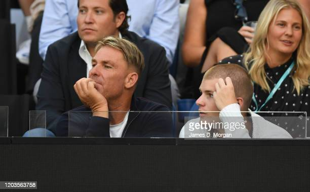 Shane Warne attends the men's singles final between Novak Djokovic of Serbia and Dominic Thiem of Austria at the 2020 Australian Open at Melbourne...