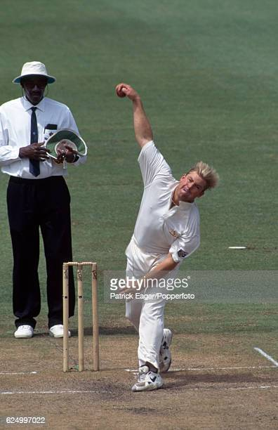 Shane Warne bowling for Australia in the 3rd Test match between Australia and England at Sydney Australia 1st January 1995 The umpire is Steve Bucknor