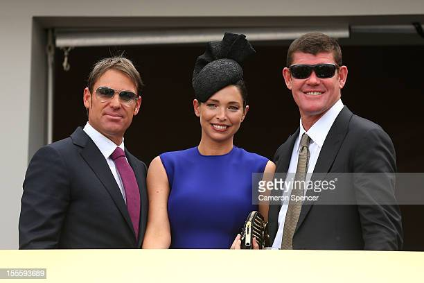 Shane Warne Erica Packer and James Packer pose for a photo in the birdcage on Melbourne Cup Day at Flemington Racecourse on November 6 2012 in...