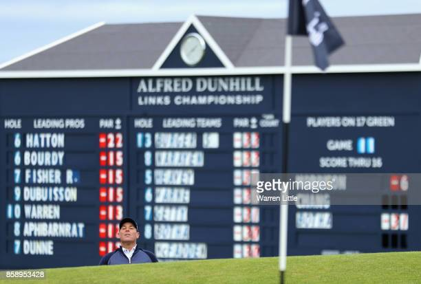 Shane Warne former Cricketer plays out of the 17th greenside bunker during the final round of the 2017 Alfred Dunhill Championship at The Old Course...