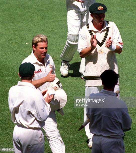 Shane Warne gives the thumbs up to his teammates forming a guard of honour after taking the Australian record for the most test wickets of 356 at...