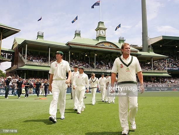Shane Warne Glenn McGrath and Justin Langer walk on to the pitch ahead of the Australian team on day one of the fifth Ashes Test Match between...