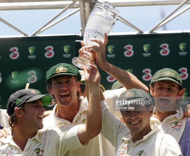 Shane Warne, Glenn McGrath, Justin Langer and Adam Gilchchrist of Australia celebrate with the Ashes trophy after winning the final test and wrapping...