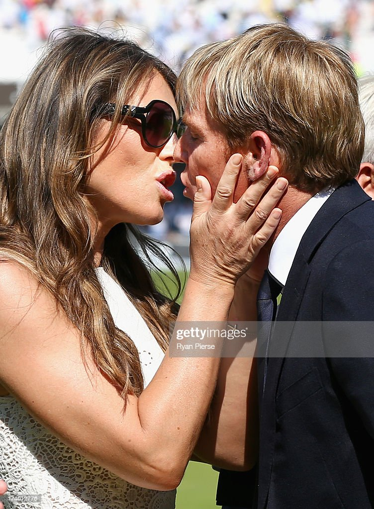 Shane Warne is congratulated by his fiance Elizabeth Hurley after he was inducted into the ICC Cricket Hall of Fame during day two of the 2nd Investec Ashes Test match between England and Australia at Lord's Cricket Ground on July 19, 2013 in London, England.