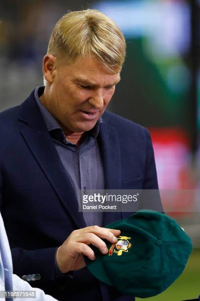 Shane Warne is seen with his baggy green cap which has been sold for more than $1 million, with all funds going to the bushfire appeal, ahead of the...