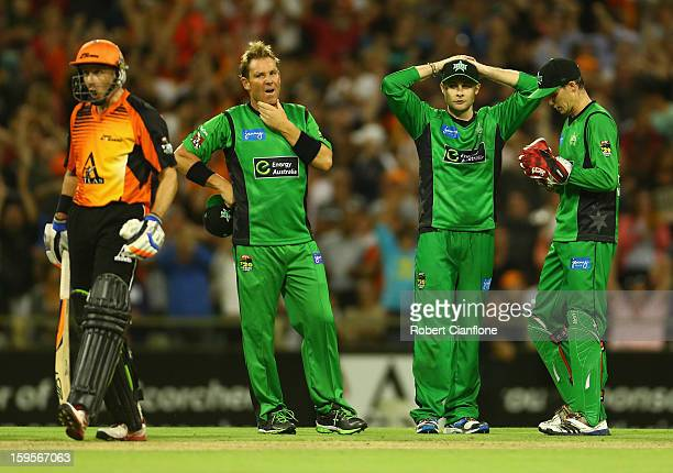 Shane Warne Luke Wright and Peter Handscomb of the Stars look dejected after the last ball was awarded a free hit during the Big Bash League...