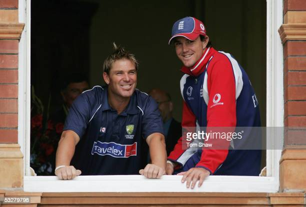 Shane Warne of Australia and Kevin Pietersen of England look out at the rain during day four of the first npower Ashes Test match between England and...