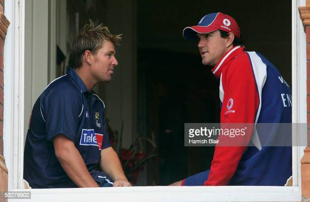 Shane Warne of Australia and Kevin Pietersen of England look out over the ground from the member's pavillion as rain delays play during day four of...